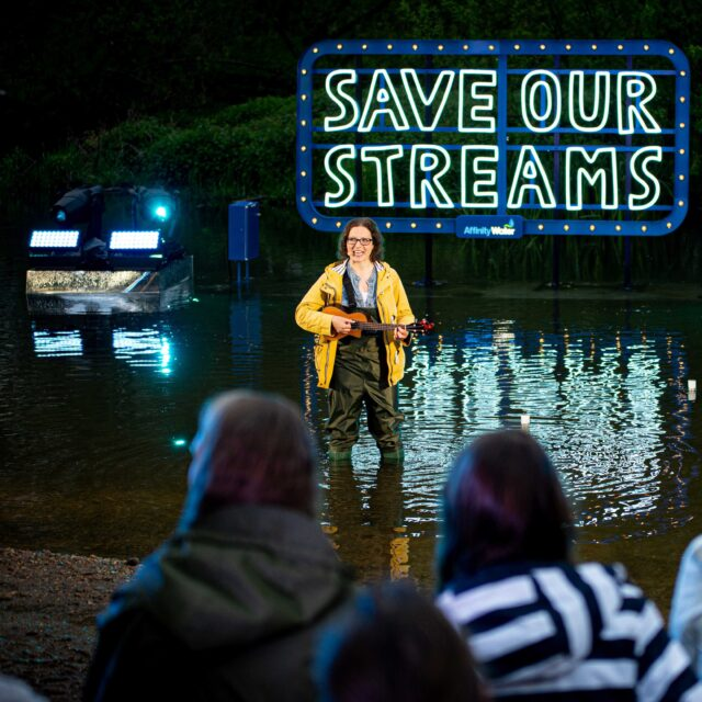 Helen standing in a stream